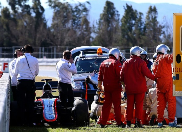 022215-motor-fernando alonso crash f1 preseason testing.vresize.1200.675.high.41