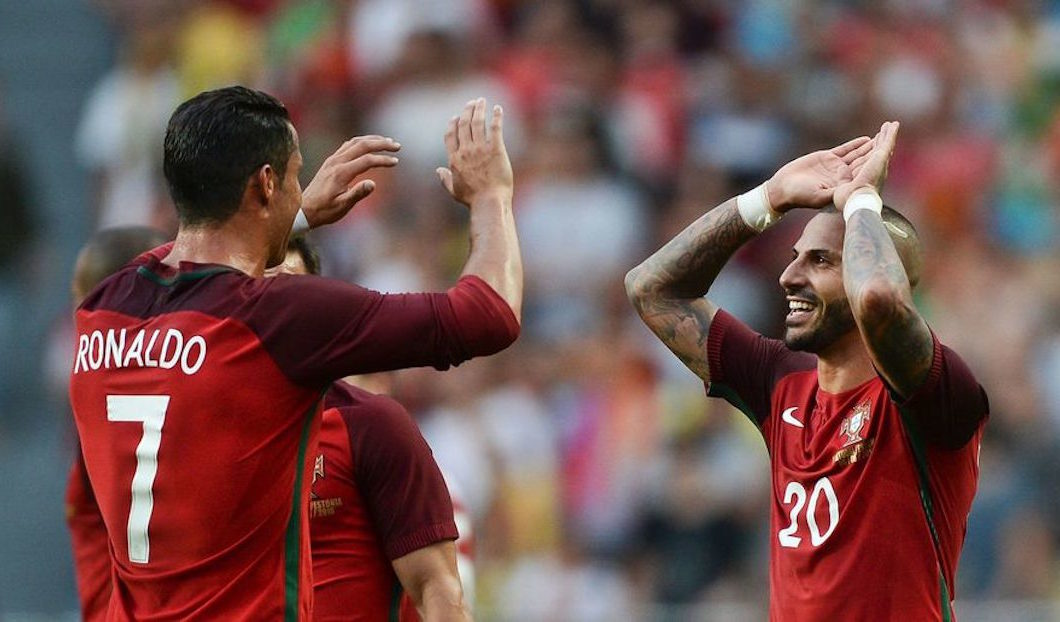 Portugal's forward Ricardo Quaresma (R) celebrates with his teammate Portugal's forward Cristiano Ronaldo (L) after scoring against Estonia during the friendly football match Portugal vs Estonia at Luz stadium in Lisbon on June 8, 2016, in preparation for the upcoming UEFA Euro 2016 Championship. / AFP / PATRICIA DE MELO MOREIRA        (Photo credit should read PATRICIA DE MELO MOREIRA/AFP/Getty Images)